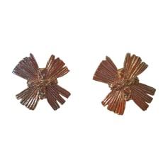 Boucles d'oreille YVES SAINT LAURENT Doré, bronze, cuivre