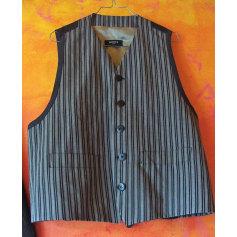 Gilet, cardigan MEXX dos noir rayé gris (fines rayures),  dDevant gris rayé noir (à rayures + larges). Doublure doré mat.