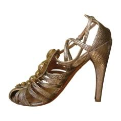 Sandales à talons ALAÏA Doré, bronze, cuivre