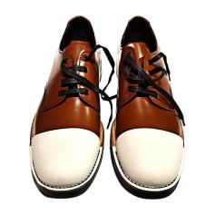 Chaussures à lacets PRADA Marron