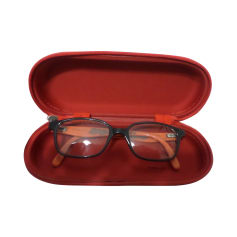 Eyeglass Frames DISNEY Rouge et noir, avec un peu d'orange.