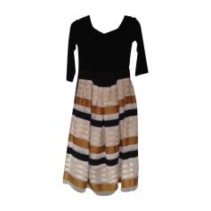 Robe mi-longue PAULE KA partie corsage noire, partie jupe, rayée