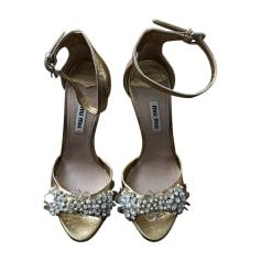 Heeled Sandals MIU MIU Golden, bronze, copper