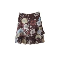 Jupe courte GERARD DAREL motifs floraux sur fond marron
