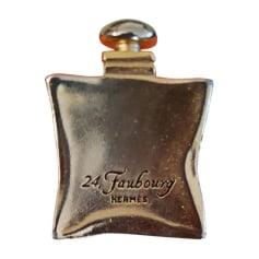 Broche HERMÈS Doré, bronze, cuivre
