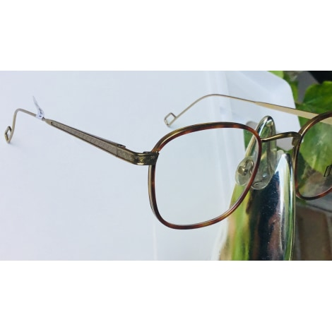 Eyeglass Frames OLIVIER LAPIDUS Golden, bronze, copper