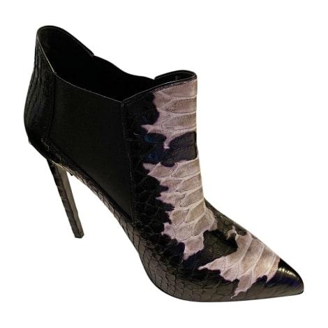 Bottines & low boots à talons SAINT LAURENT Noir et blanc