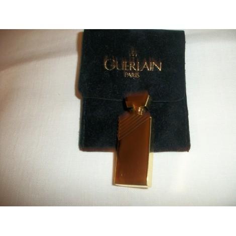 Broche GUERLAIN Doré, bronze, cuivre