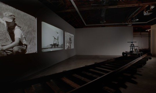 Pumping, 2010, Three Blu-ray discs, handcar, water jug, railroad tracks, film strips/pile of metal, Dimensions variable, Installation View