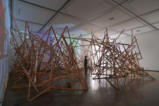 bowrain, 2010, wood, wire, twine, sound composition, 6 audio speakers, 3 cd players, 3 stereo amplifiers, ink on 16mm film stock transferred to video, 3 dvd players, 3 video projectors, Site specific installation - dimensions variable (approx 45' x 45')