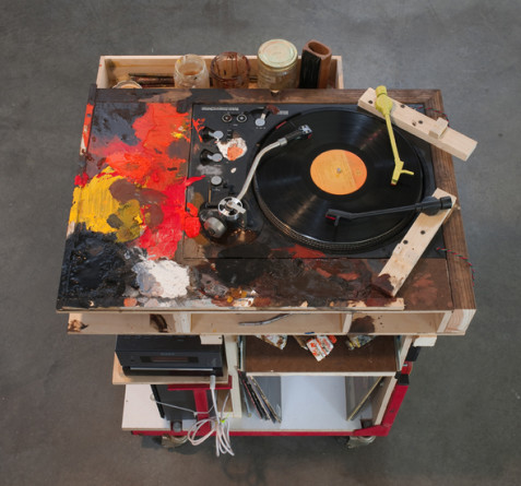 "The Palette, 2009, Engine stand, 3 turntables (2 portable), shelf radio, 9 records, 3 jars, 3 paint brushes, record cleaner, 5 tubes of paint, pliers, and speakers, 34"" x 30"" x 24"""