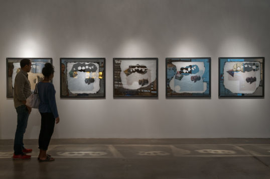 PLATONIC SOLIDS DREAMING/DETROITS SHRINKING, 2014, Painting on mirrored glass, graphite and ink on vellum, layered over colored paper, in a hand crafted steel frame, Five parts, each 38, Photo credit: Robert Wedemeyer