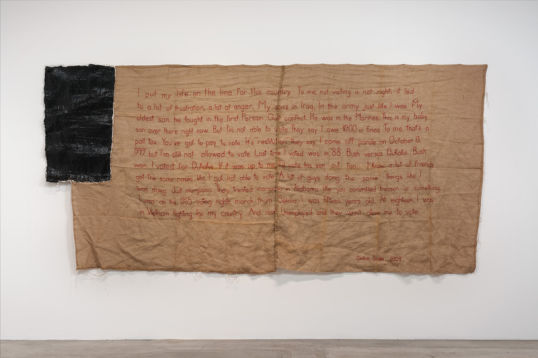 "Untitled (flag IV), 2012, Burlap, thread, plaster and latex, 80"" H x 169"" W"