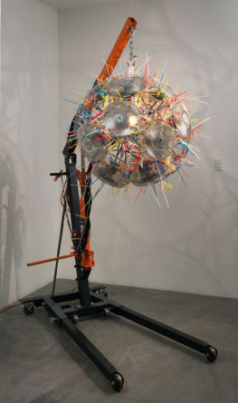 "The Void, 2009, 20 fans, 10"" diameter each, zip ties, clip lamp, and engine hoist, 93"" x 33"" x 64"""