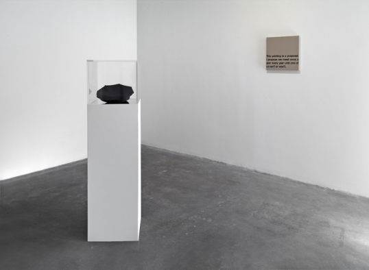 "Untitled, 2009, Hat and photo with mirror, pedestal and plexiglass case, 13"" x 13"" x 55"""