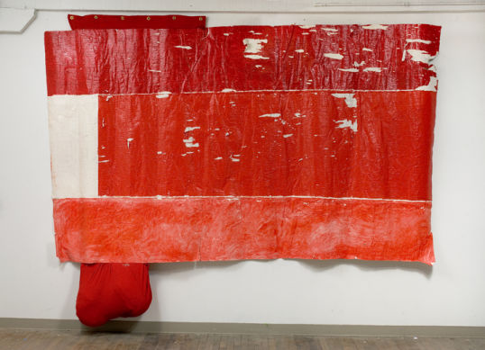 Untitled (flag), 2006-2008, Mixed media, acrylic on un-stretched canvas, fabric, grommets, Approx. 11 x 9.5 x 1.5 ft, CA Biennial 2008, OCMA