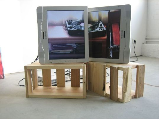 "Hey Jude, 2007, two 15"" TV monitors, two DVD players, two wooden crates, two DVDs, ten LPs, 23"" x 31"" x 24"" (detail)"