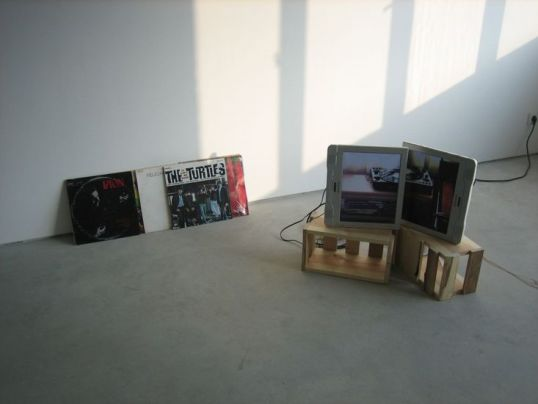 "Hey Jude, 2007, two 15"" TV monitors, two DVD players, two wooden crates, two DVDs, ten LPs, 23"" x 31"" x 24"""