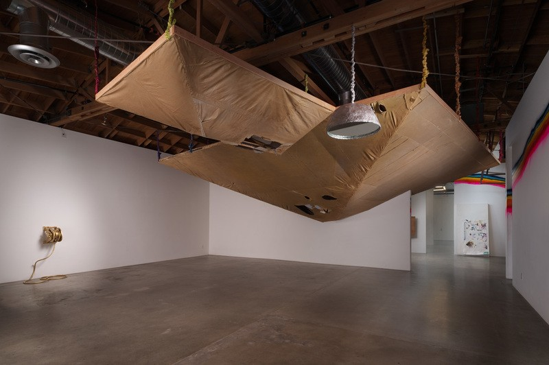 "Olga Koumoundouros, ""Possessed by Glint and Dreams"", Installation shot including ""Gold Roof"", 2013 Wood, painters tarps, gold paint and bed sheets; From ""A Notorious Possession"", site specific installation in Los Angeles, CA"