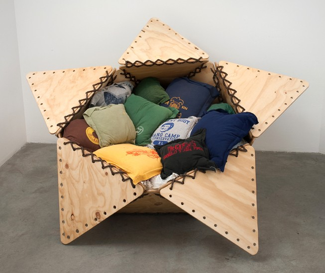 "The Tunix of My Apathy I, 2007, Plywood, rope, 20 t-shirts sewn into pillows, stuffing material, 45"" x 60"" x 75"""