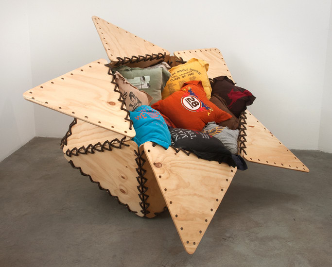 "The Tunix of My Apathy II, 2007, Plywood, rope, 20 t-shirts sewn into pillows, stuffing material, 45"" x 60"" x 75"""