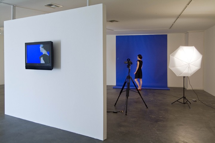 "Preamble, 2009, NTSC color video with sound, chroma keyer, lights, paper, ""Ready to Die"" CD, headphones, Dimensions variable"