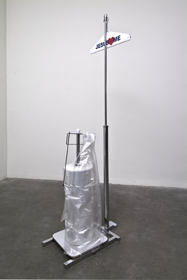 "On Premises, 2009, Hanger with text, garment bagging apparatus, Approx. 67"" tall, 17 ½"" wide, 22"" deep"