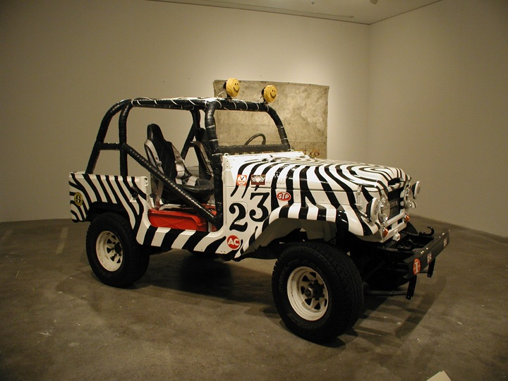 "Car 21, 2008, 1964 Toyota Land Cruiser, oil paint, stickers, 73"" x 154"" x 80"", Miami Art Museum"