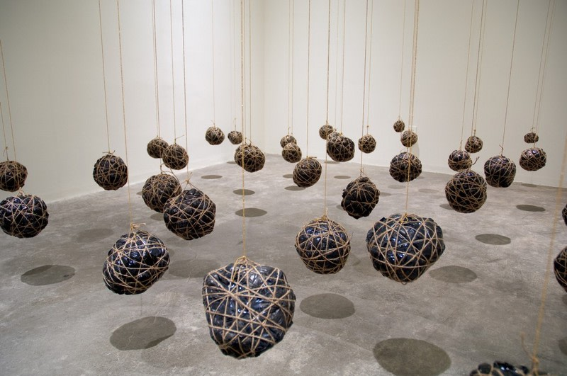 "Suspended playtime, 2008, Garbage bags, twine 44 parts, variable sizes, from 2"" to 8"" diameters"