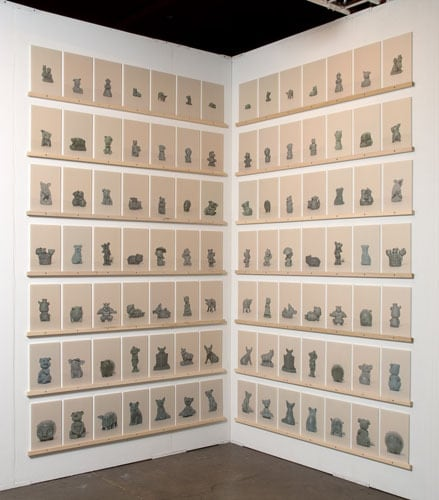 "Group Formation Studies (Fronts and Backs), 2007, Inkjet prints on newsprint on Plexiglass, wood shelf, Each panel 12"" x 8""; 7 Groups of 14 panels each,   installation view"