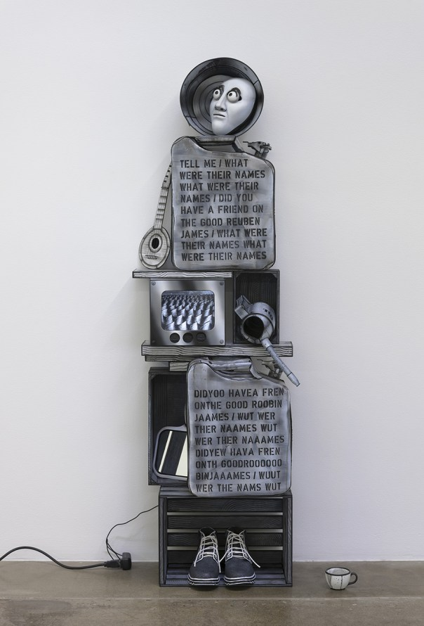 "Memorial to the USS Reuben James, 2018, Custom monitor with custom electronics and video with sound; painted wood, metal, leather, and glass; painted neopreme and polymer clay mask, 72 x 28 x 15"" [HxWxD] (182.88 x 71.12 x 38.1 cm), Photo credit: Robert Wedemeyer"