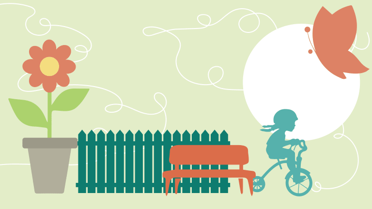 Child riding a bike in front of a fence and a flower for the Lachine community lanes program