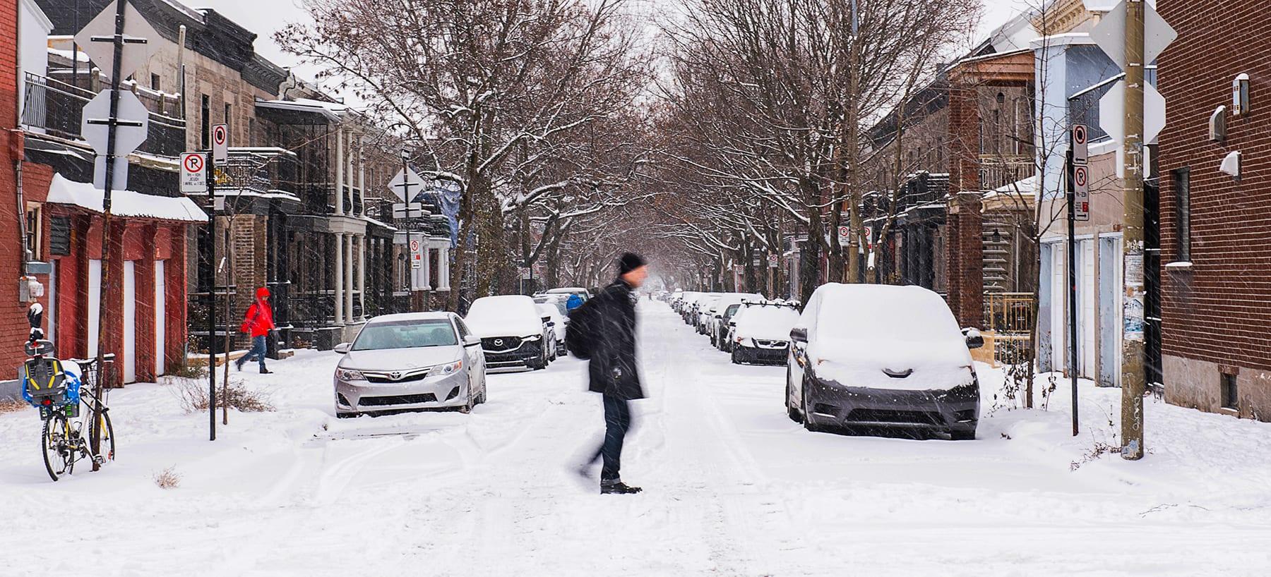Pedestrian crossing a snowy street