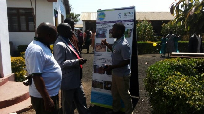Nane nane event at Mbeya 08/08/2017: Venanti Lulukila, SHIPO staff explaining to the people on WASH SMART Technologies