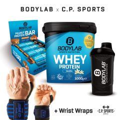 1 x 1000g Whey Protein + Peanut-Caramel Protein Bar (12x55g) + BL24 Shaker + Profi Handgelenkbandagen