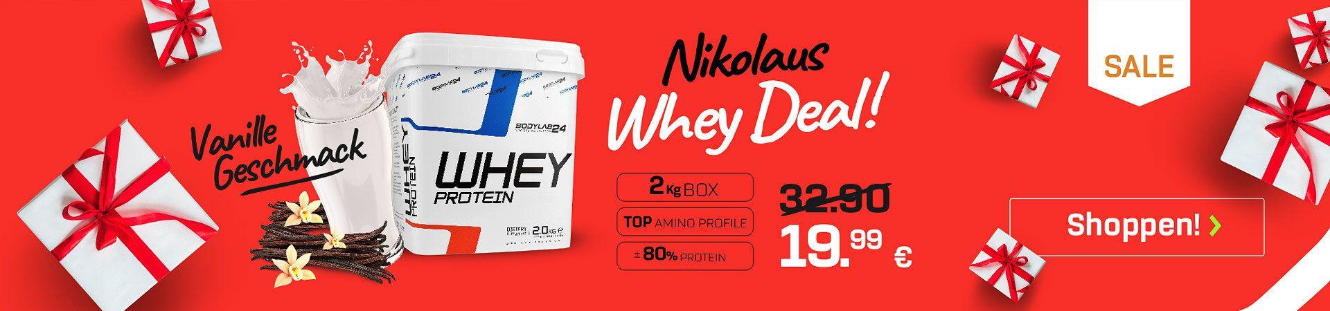 Whey Dose vor rotem Hintergrund, mit Vanilleschoten und Milchglas - Verweis auf den Nikolaus Whey Deal