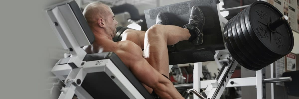 man in legpress machine