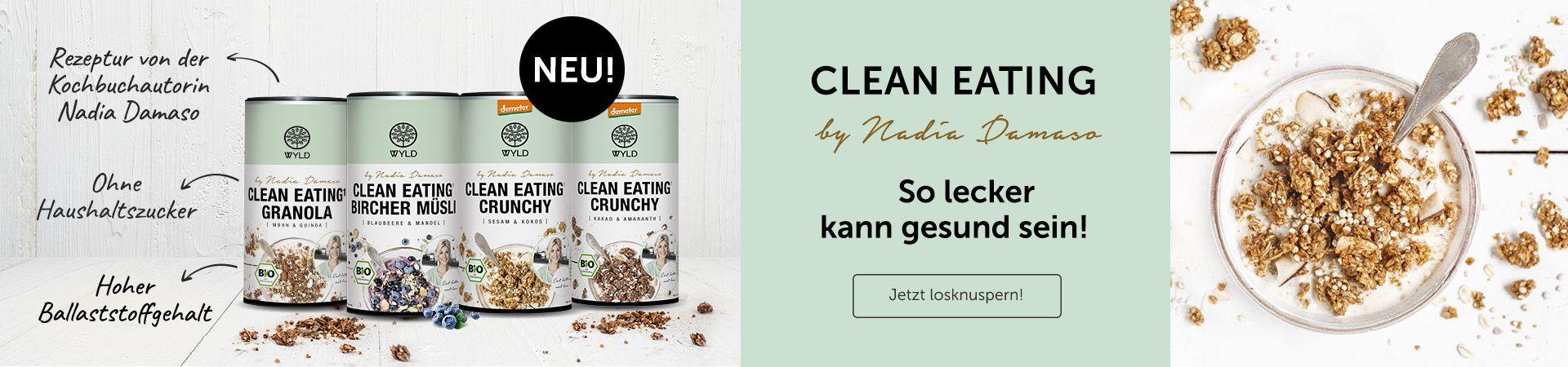 Das Banner zeigt die Clean Eating Müsliserie der Bestseller-Autorin und Food-Influencerin Nadia Damaso und WYLD: das Clean Eating Granola mit Mohn und Quinoa, das Clean Eating Bircher Müsli und die Clean Eating Crunchy Müslis Sesam-Kokos und Kakao-Amaranth.