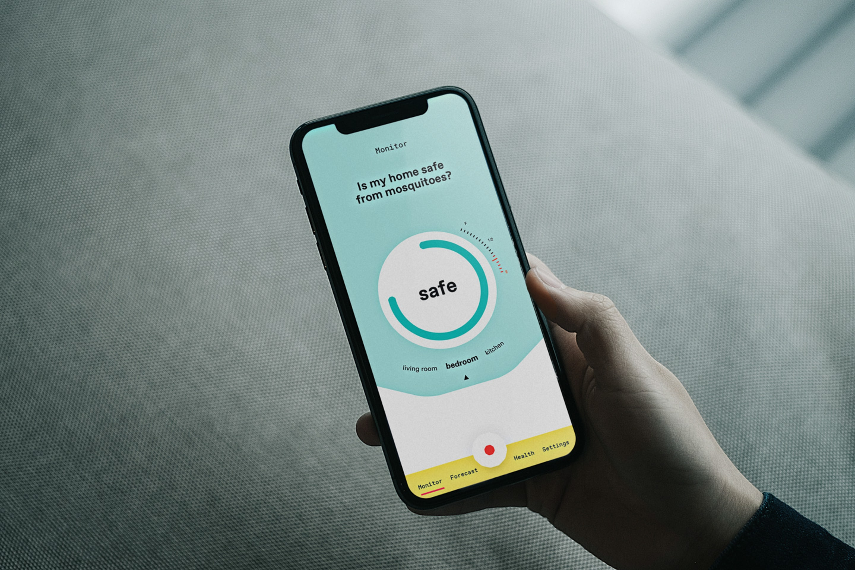 Person holding an iPhone X with an App prototype