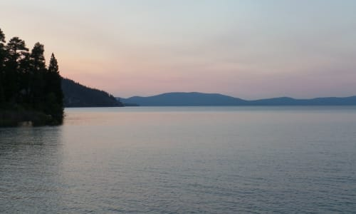 Far View of the Mountains with the M.S. Dixie II Sightseeing and Sunset Dinner Cruises