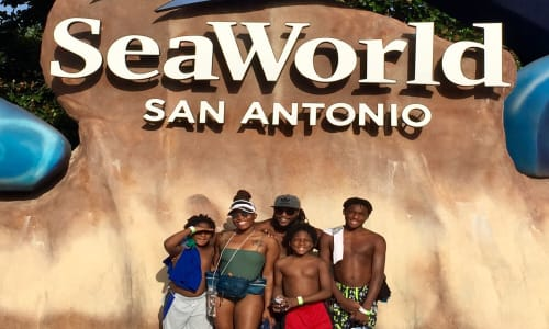 Family in Front of the Sign for SeaWorld San Antonio