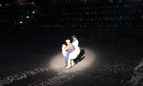 Riding a Chicken at Dolly Parton's Stampede Dinner and Show Branson