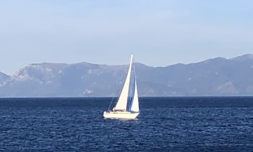 Sailboat with Lake Tahoe Sightseeing Cruises Aboard the Bleu Wave