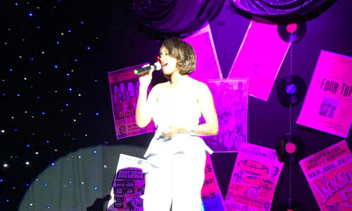 Woman Singing at Motor City Musical A Tribute to Motown