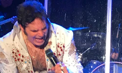 Elvis Impersonater at the Tribute to the King: Thru the Years 53-77