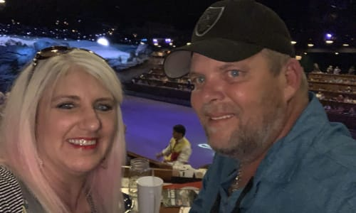 Couple Enjoying Dinner at Dolly Parton's Stampede Dinner Show Pigeon Forge