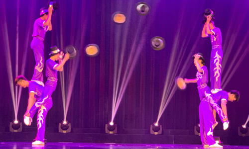 Throwing Hats at the Amazing Acrobats of Shanghai