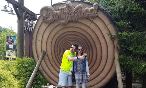 Pic with a Dollywood Wooden Sign at Dollywood Theme Park