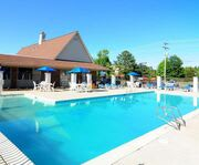 Outdoor Pool at Days Inn & Suites by Wyndham Williamsburg Colonial