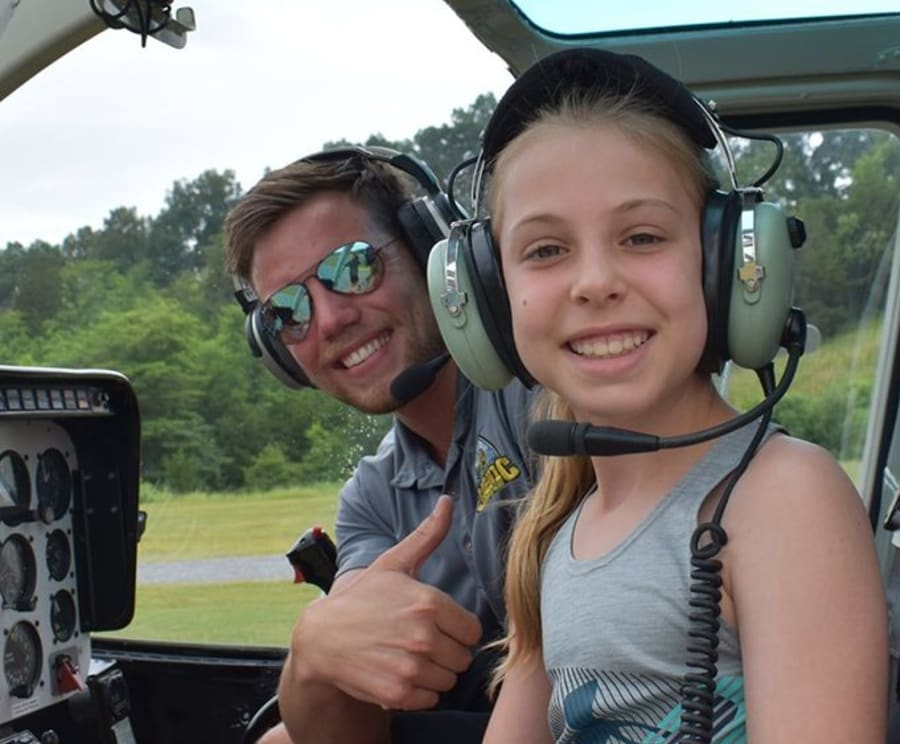Family Enjoys Fly the Scenic Skies wiht Scenic Helicopter Tours